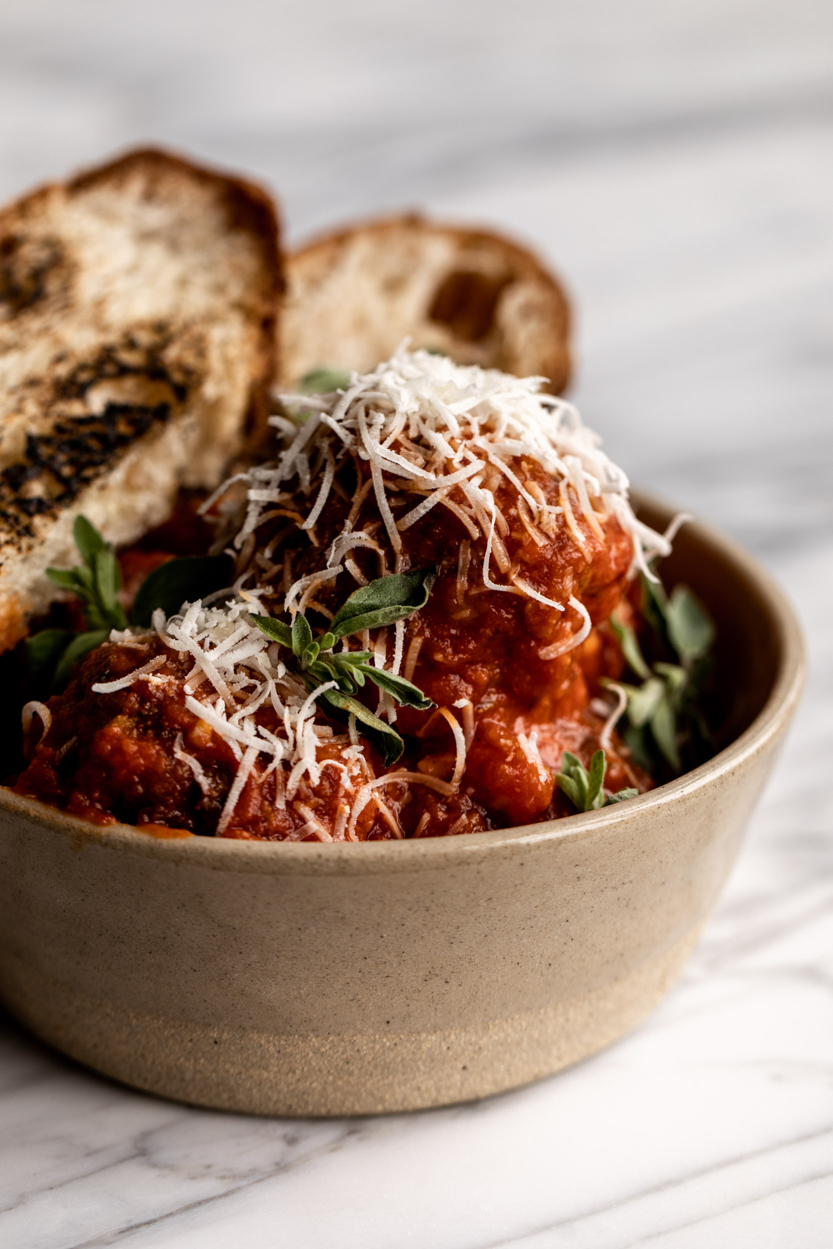 This Italian meatball recipe is made with a combination of 3 types of meat: beef, pork & prosciutto which adds flavor and keeps them moist