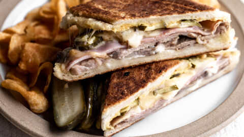 cuban sandwich with roast pork, ham, swiss cheese and pickles