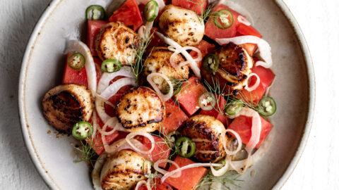 scallops are seared to golden-brown and are served in a nutty brown butter sauce that contrasts with the fresh, sweet taste of watermelon and spicy Serrano pepper
