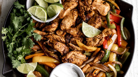 tequila lime and chili chicken fajitas with bell peppers and onion