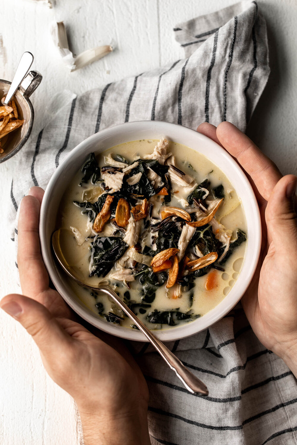 "Turkey and Wild Rice Soup with Garlic Oil I like this recipe for Thanksgiving leftovers because it is a nice change of pace from feeling "" over holiday themed "" . The comforting soup is great for rainy days!"