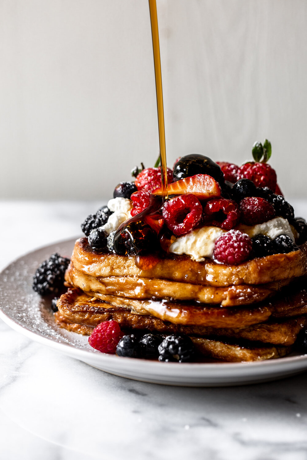 Brioche French Toast Topped with Fresh Berries and Whipped Cream | 17 Recipes for Your Easter Celebration