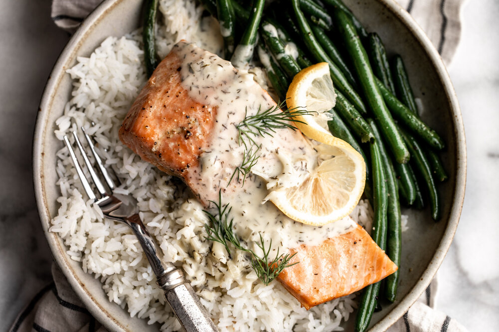baked lemon dill salmon with green beans and steamed rice in a stone bowl