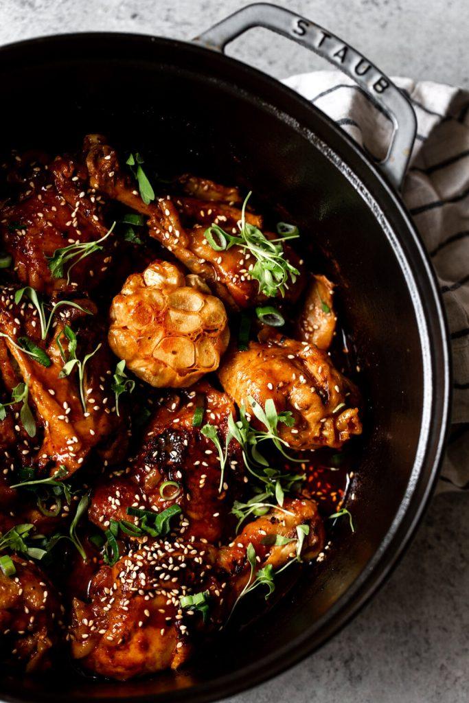 Braised Garlic Gochujang Chicken Legs in staub dutch oven