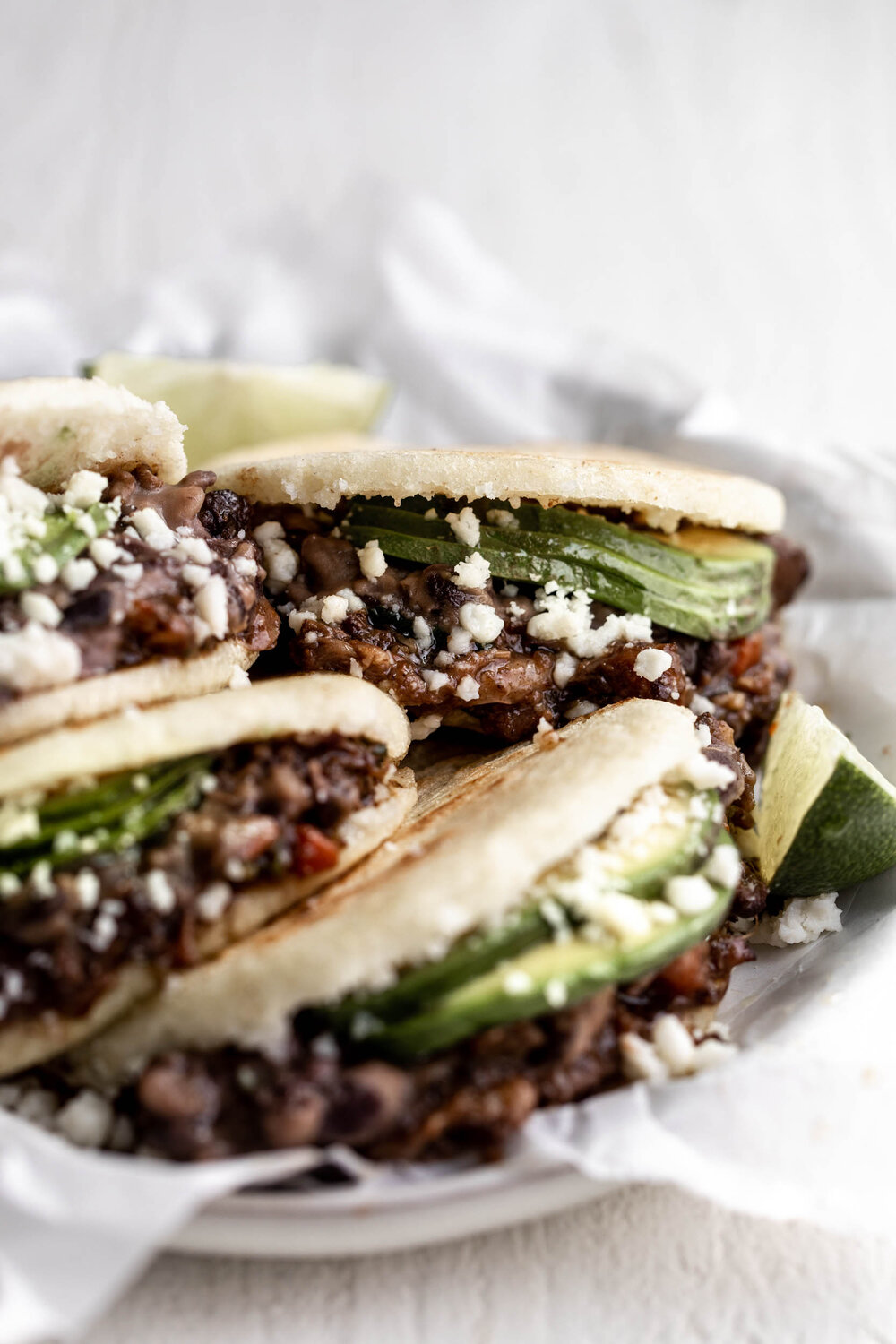 Braised Oxtail Arepas with Avocado & Black Beans