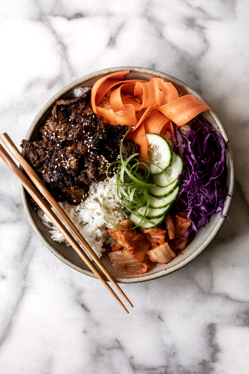 Bulgogi, Korean BBQ beef, is thinly sliced beef marinated in a soy-based sauce cooked until the sauce caramelizes and served over rice.