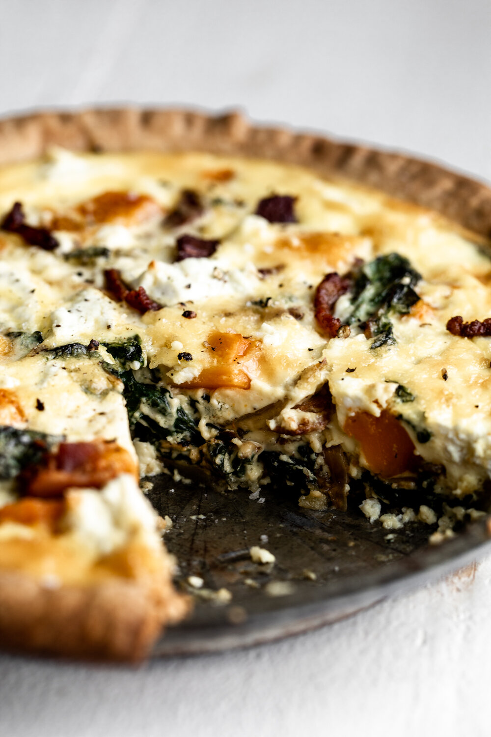 Easy quiche recipe made with store-bought quiche and seasonal fall ingredients of butternut squash, chard and bacon quiche for breakfast.