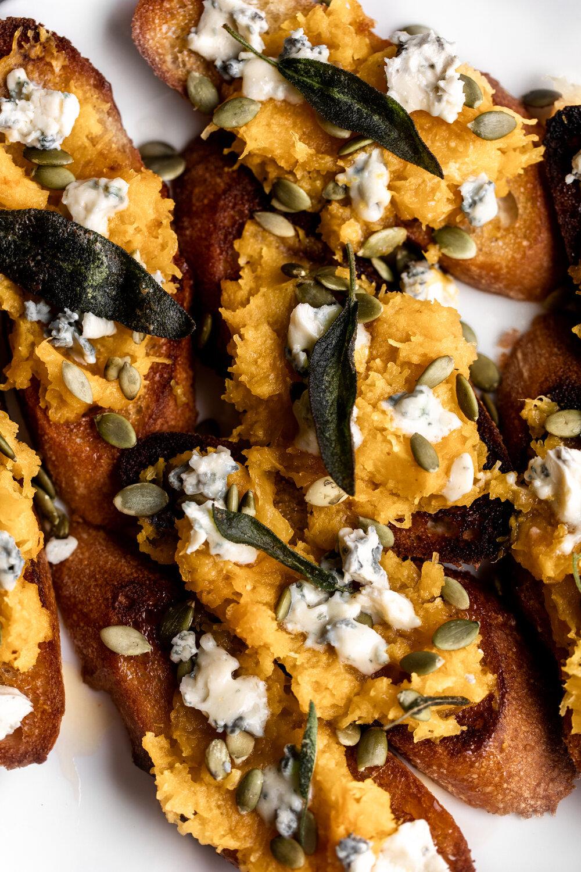 Maple Roasted Pumpkin Crostini with Blue Cheese & Pumpkin Seeds