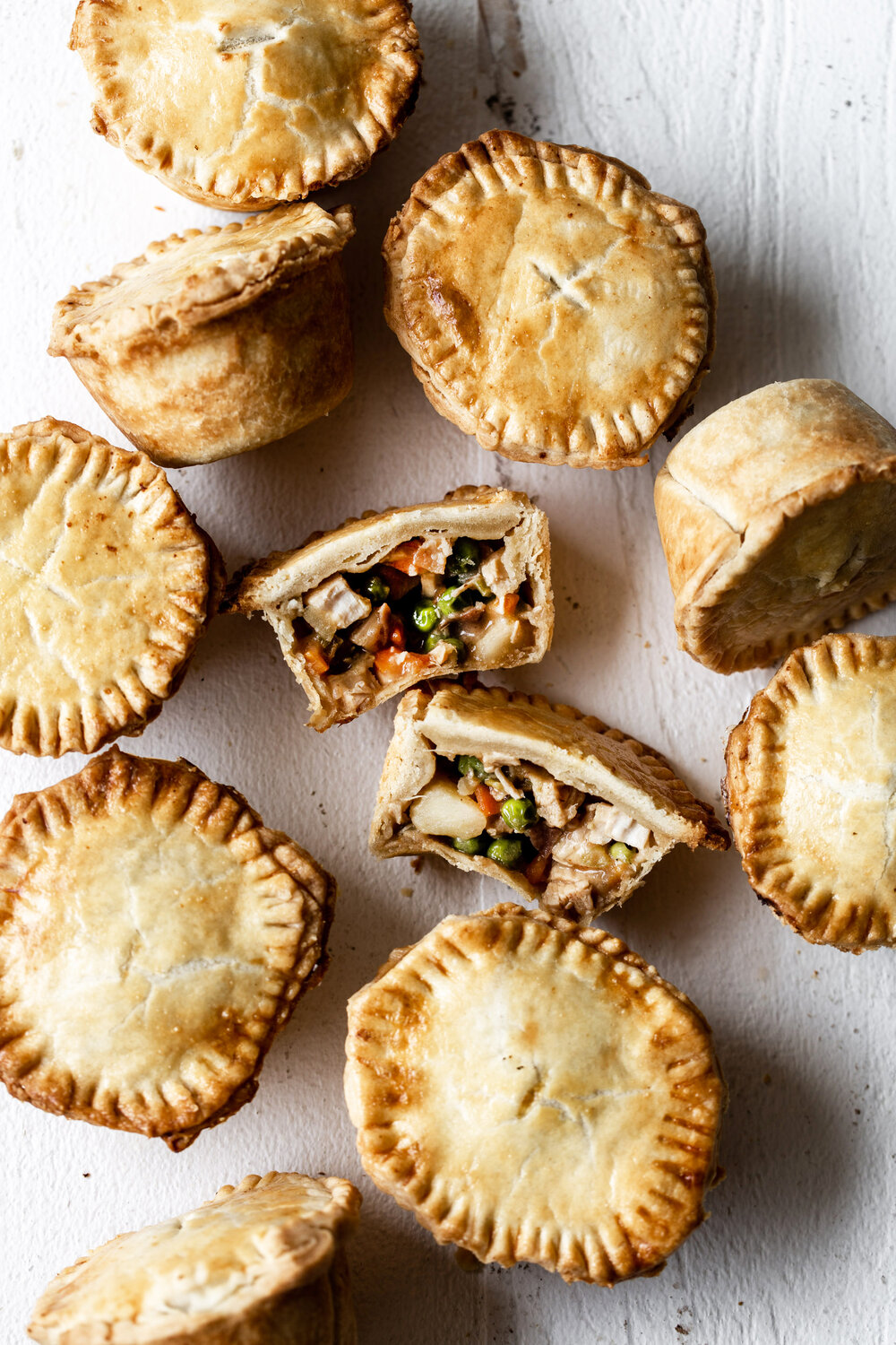Mini chicken pot pies filled with vegetables, creamy chicken and prosciutto in a flakey, buttery crust make the perfect bite-size dinner.