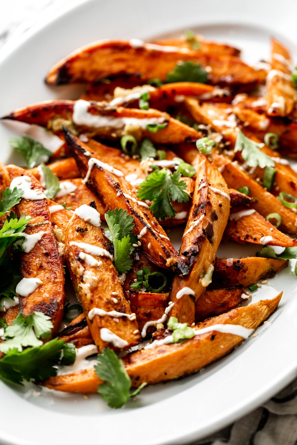 This oven roasted sweet potato recipe is tossed in miso butter for a unique and delicious versatile root vegetable side.