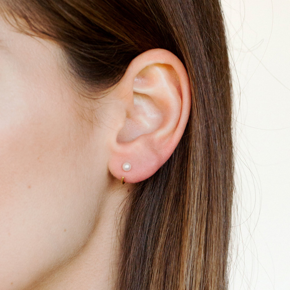 Octavia Elizabeth White Pearl Ear Huggies I gave a pair of these trendy ear huggies to each of my bridesmaids as a thank you!