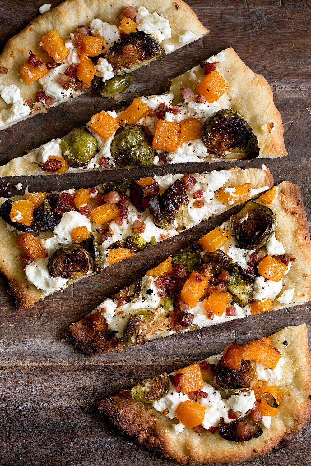 Roasted Butternut Squash & Balsamic Brussels Sprouts Flatbread Pizza with Goat Cheese Take your leftover roasted vegetables and spread them onto this flatbread! You could even add sautéed greens as well.