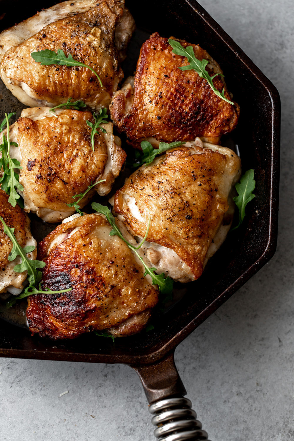 - Simple Salt & Pepper Cast Iron Chicken Thighs- This simple chicken thigh recipe can be paired with everything from rice and vegetable and topped with alfredo pasta cream sauce or paired with a simple Caesar salad.