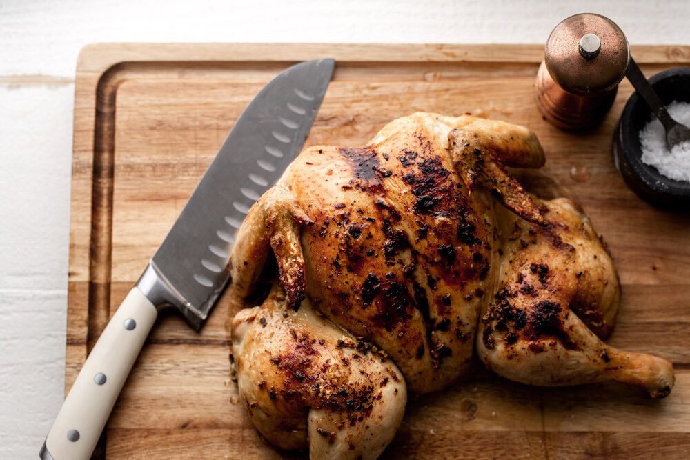 lemon garlic spatchcocked chicken on cutting board