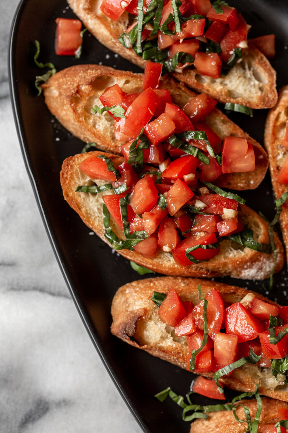 - Bruschetta- At its core this recipe is seasoned, chopped tomatoes over toasted bread. The Italian classic is easy to make and incredibly flavorful.