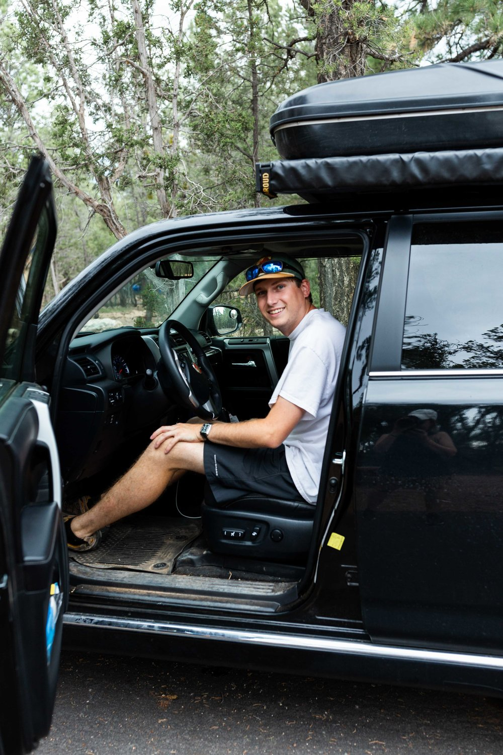 josh in toyota 4runner cooking with cocktail rings camping