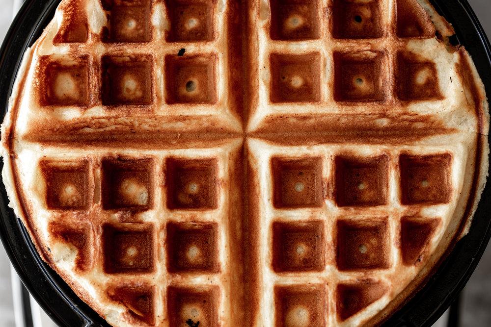 closeup waffle in iron