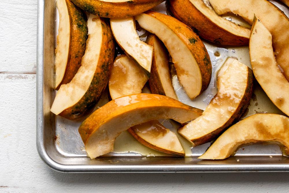 acorn squash ingredient shot on baking sheet