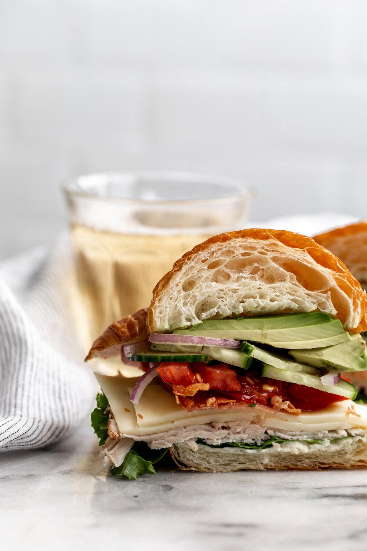 Croissant Club Sandwich with Crispy Prosciutto cut open