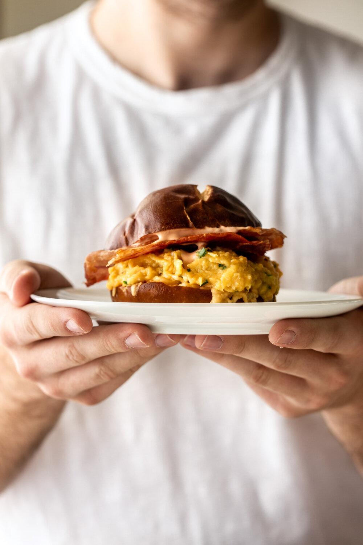 Egg, Cheese & Crispy Prosciutto Breakfast Sandwich on a Pretzel Bun