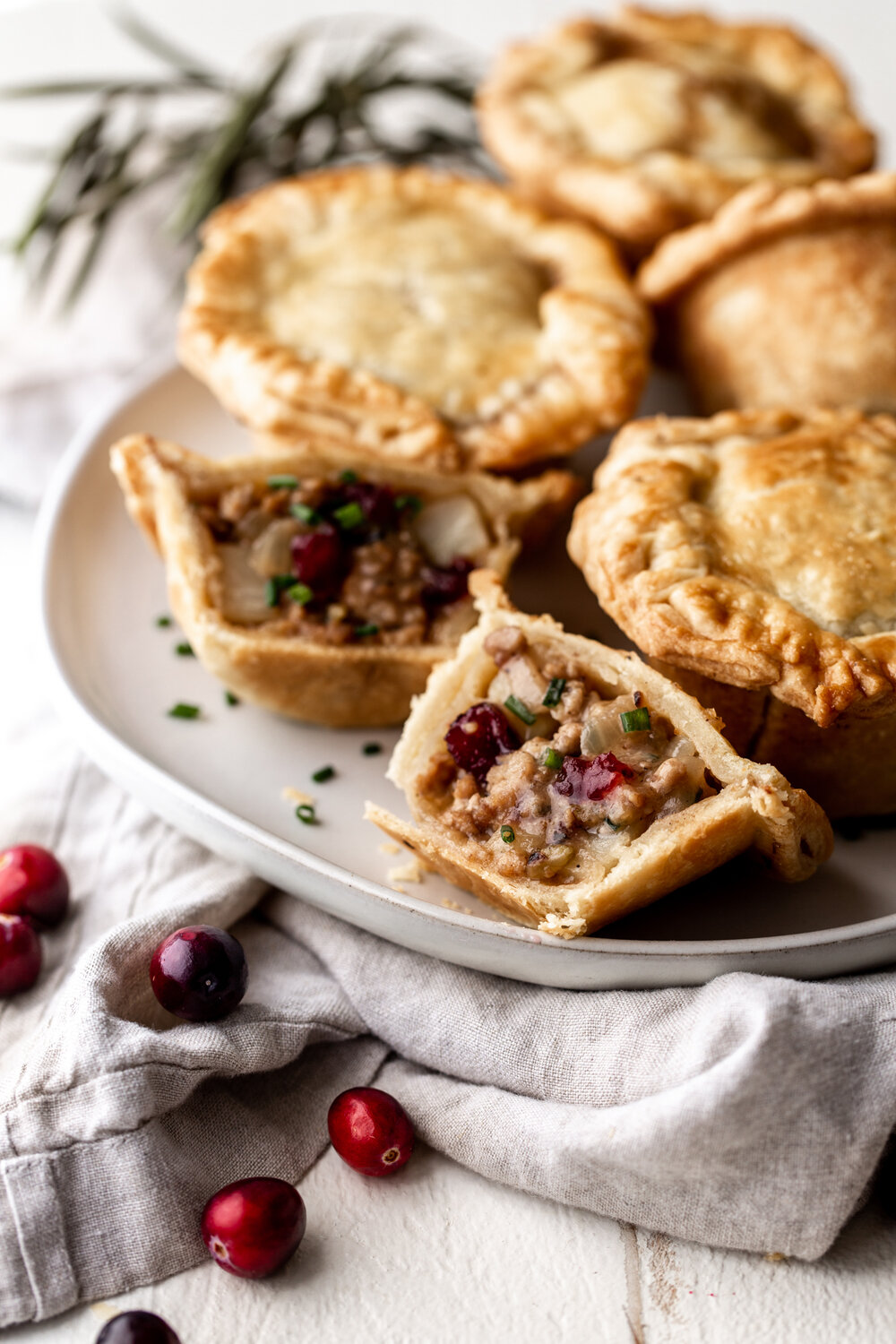 Mini Thanksgiving Turkey & Cranberry Pot Pies cooking with cocktail rings