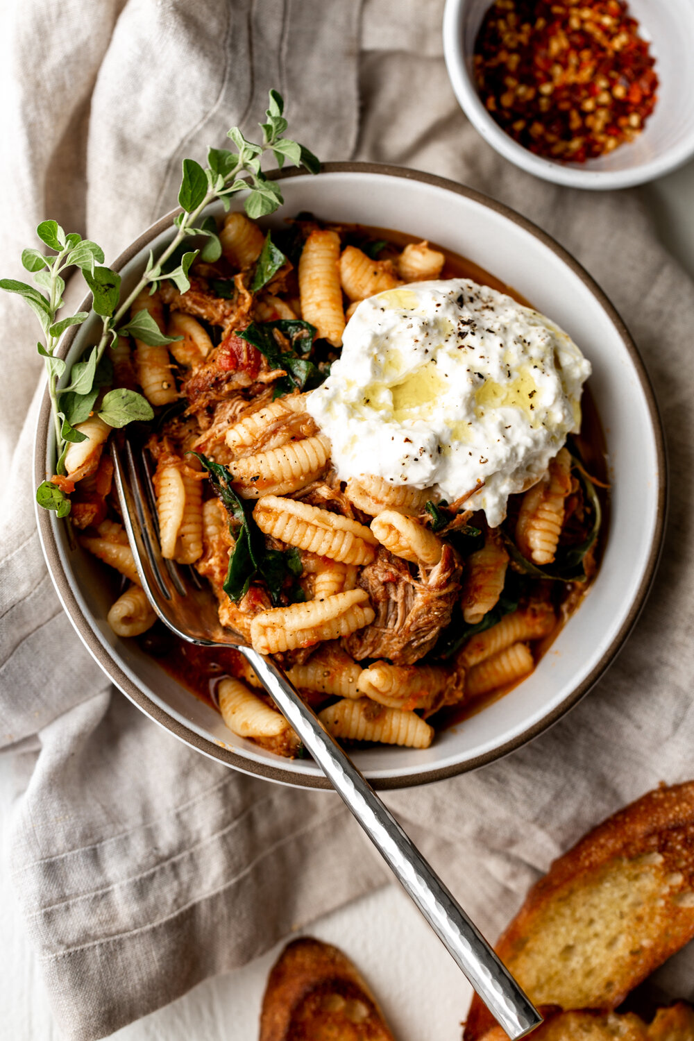 The braised pork ragù is served over pasta and topped with creamy burrata cheese for one of my favorite hearty meals for a cozy night in.