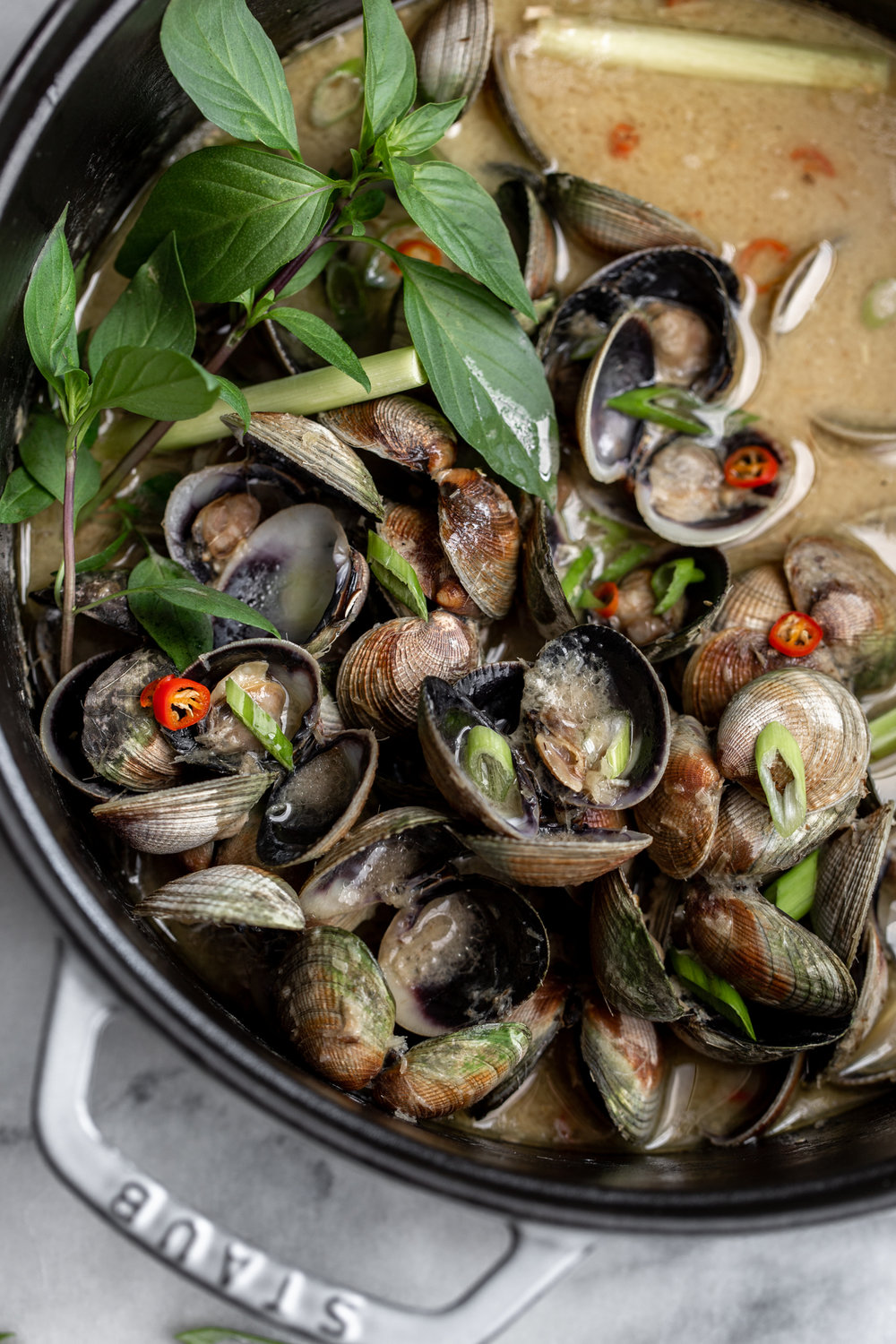 thai lemongrass coconut clams recipe from cooking with cocktail rings closeup