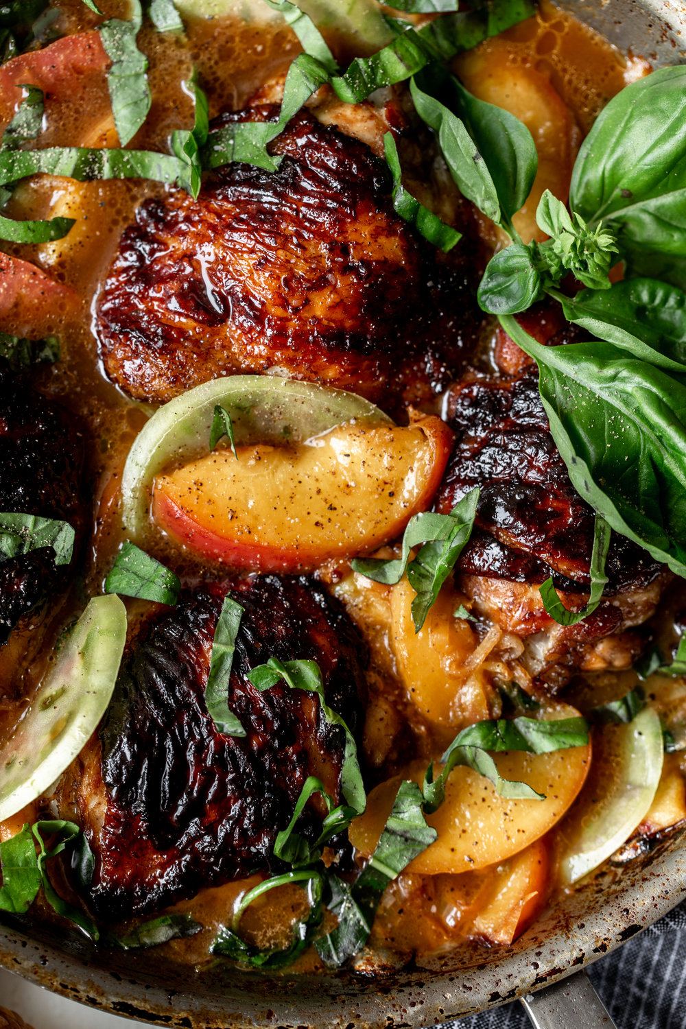 Honey Balsamic Chicken Thighs with Peaches recipe from cooking with cocktail rings closeup