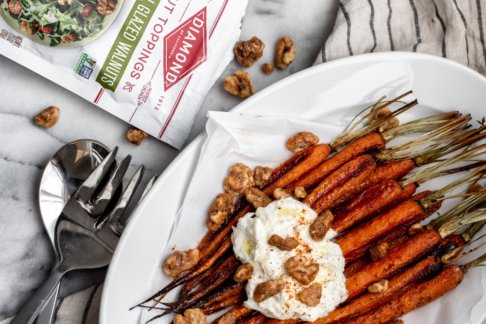 The roasted carrots are seasoned simply with salt, pepper and a touch of cayenne for a bit of spice then topped with creamy burrata cheese and some crispy, glazed walnuts