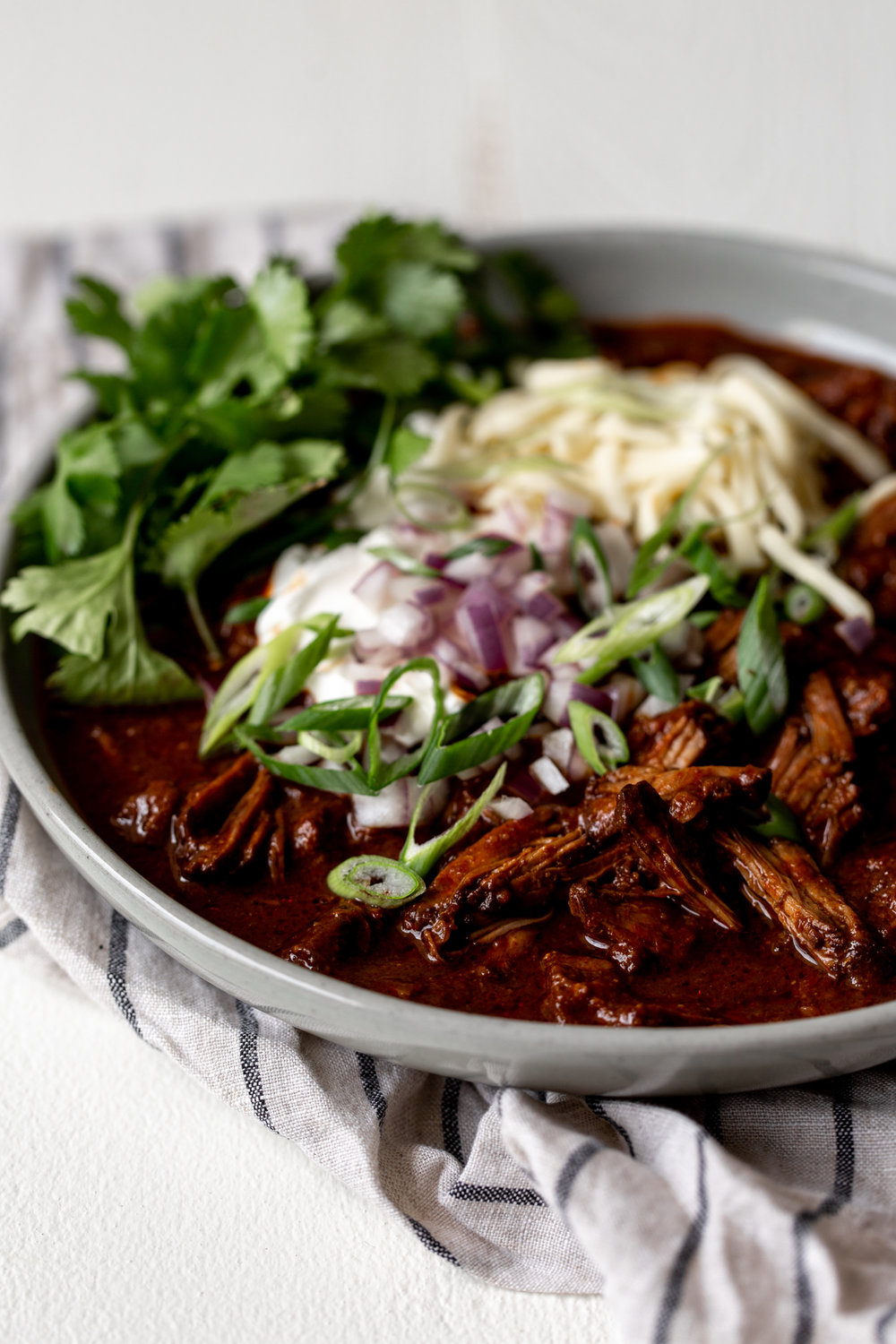This chili con carne, a Texas-style braised short rib chili recipe -  builds smoky heat from the roasted guajillo, ancho and arbol chilies.