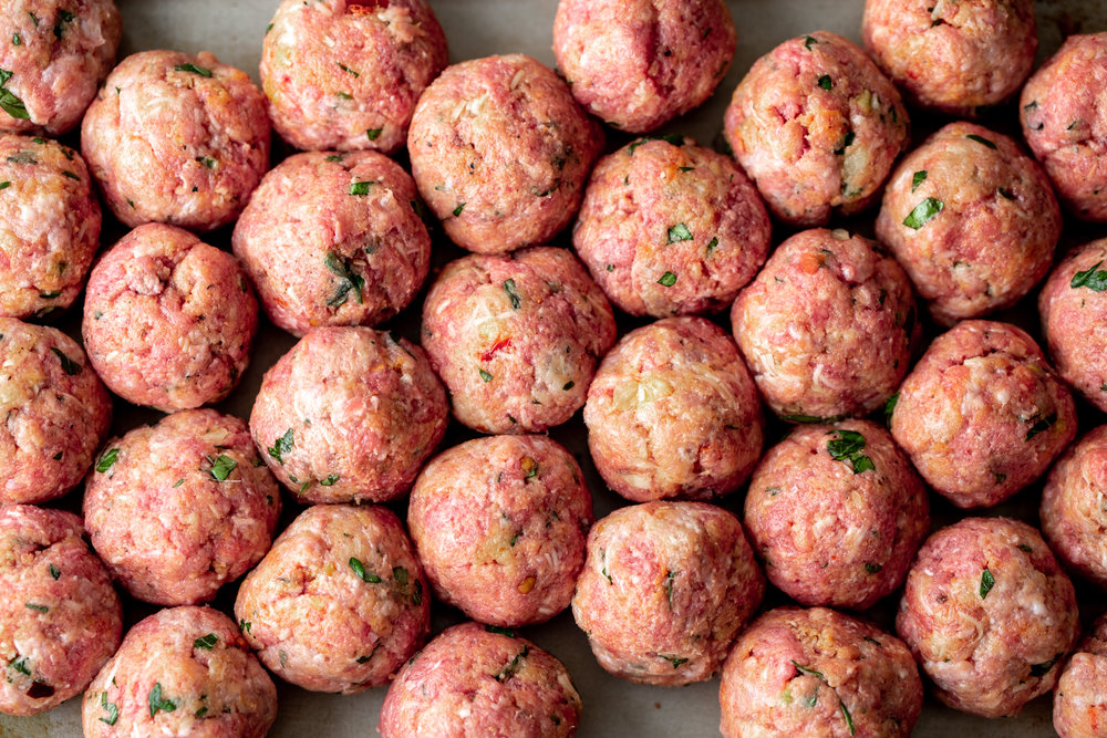 raw spicy beef and pork meatballs ready for oven