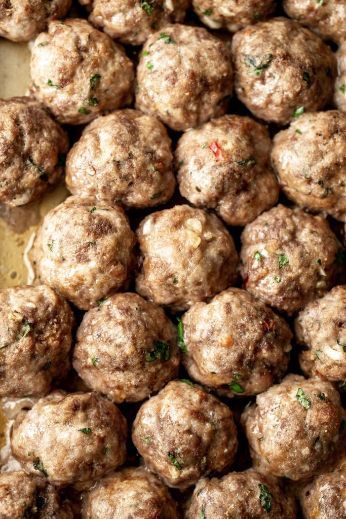 closeup meatballs on a baking sheet