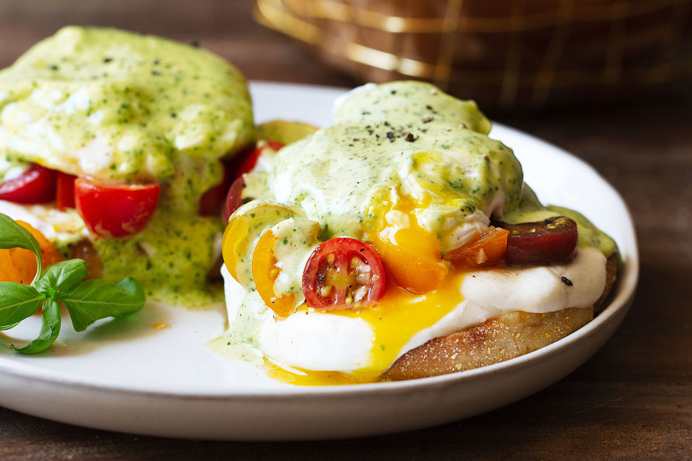 BelGioioso caprese eggs benedict with basil hollandaise recipe from cooking with cocktail rings closeup yolk
