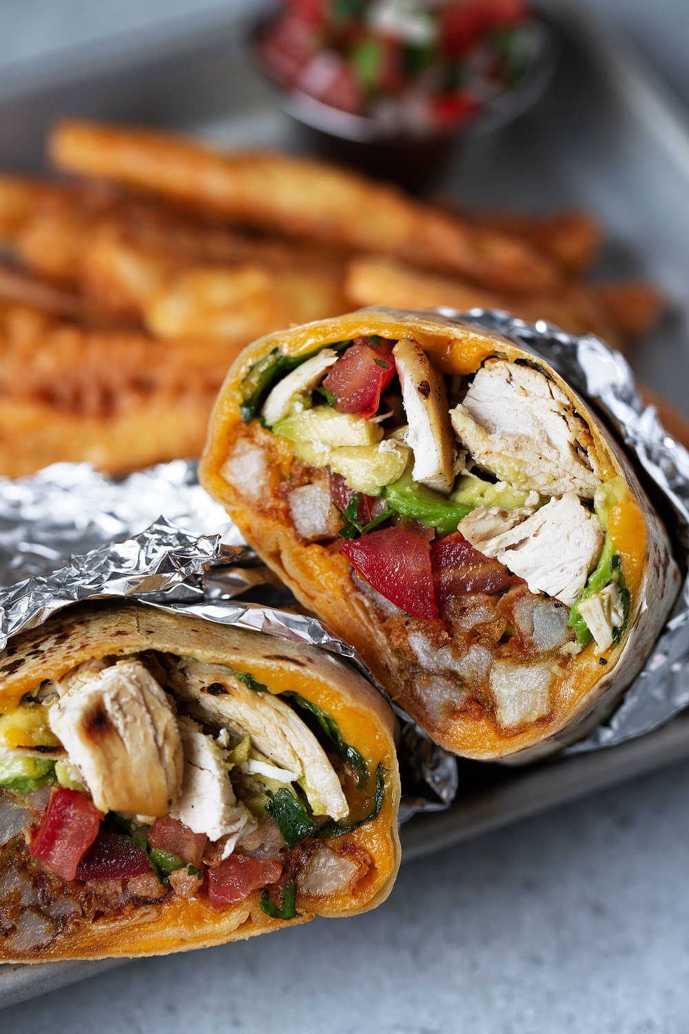 california chicken burrito with seasoned fries cooking with cocktail rings