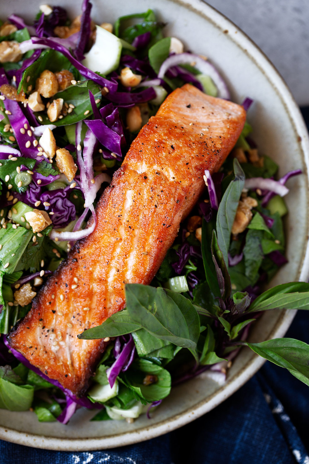 Crispy seared salmon over a base of bok choy and cabbage with a spicy, funky Thai dressing and topped with candied peanuts.