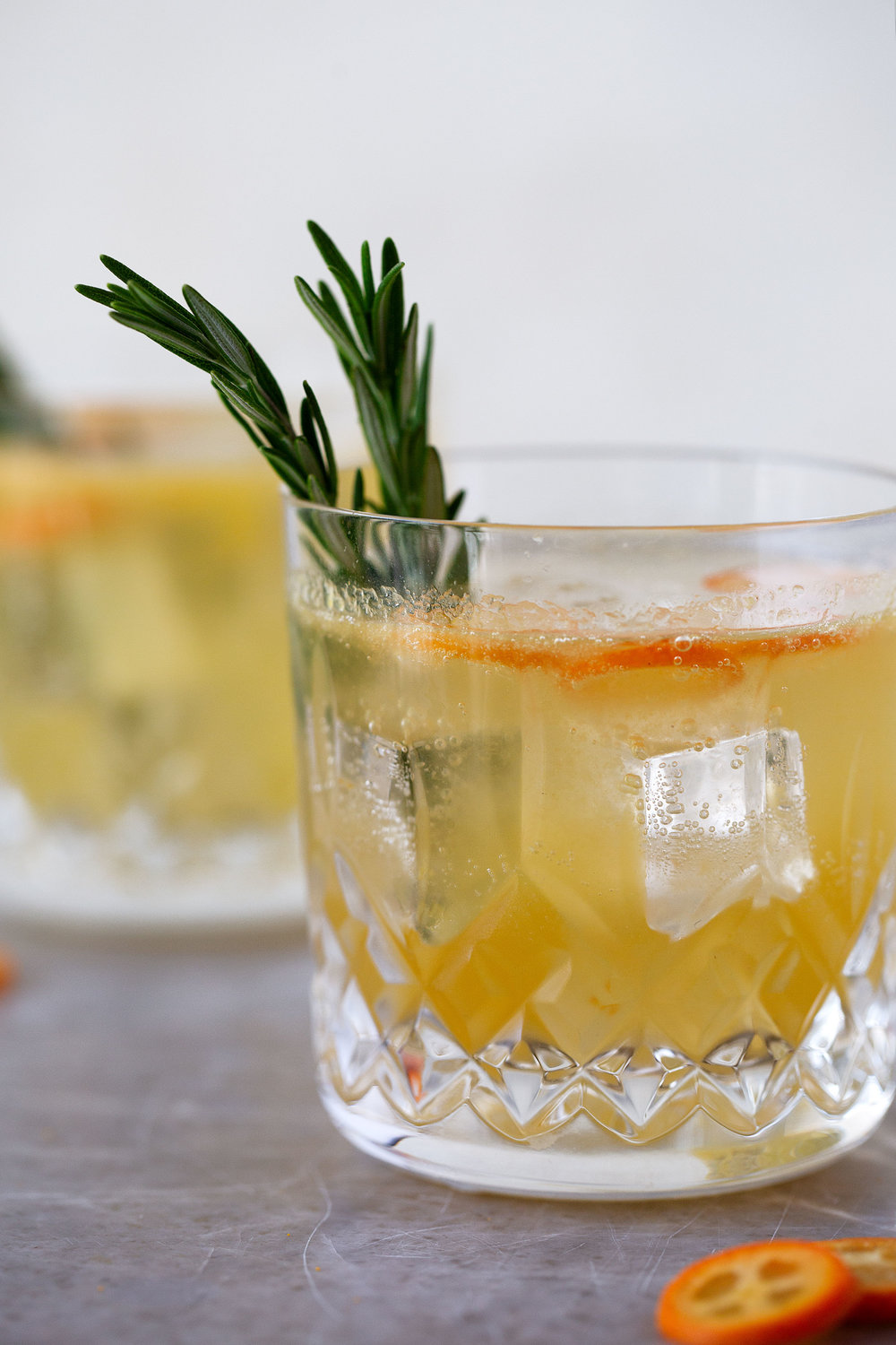 rosemary kumquat gin fizz cocktail recipe from cooking with cocktail rings closeup