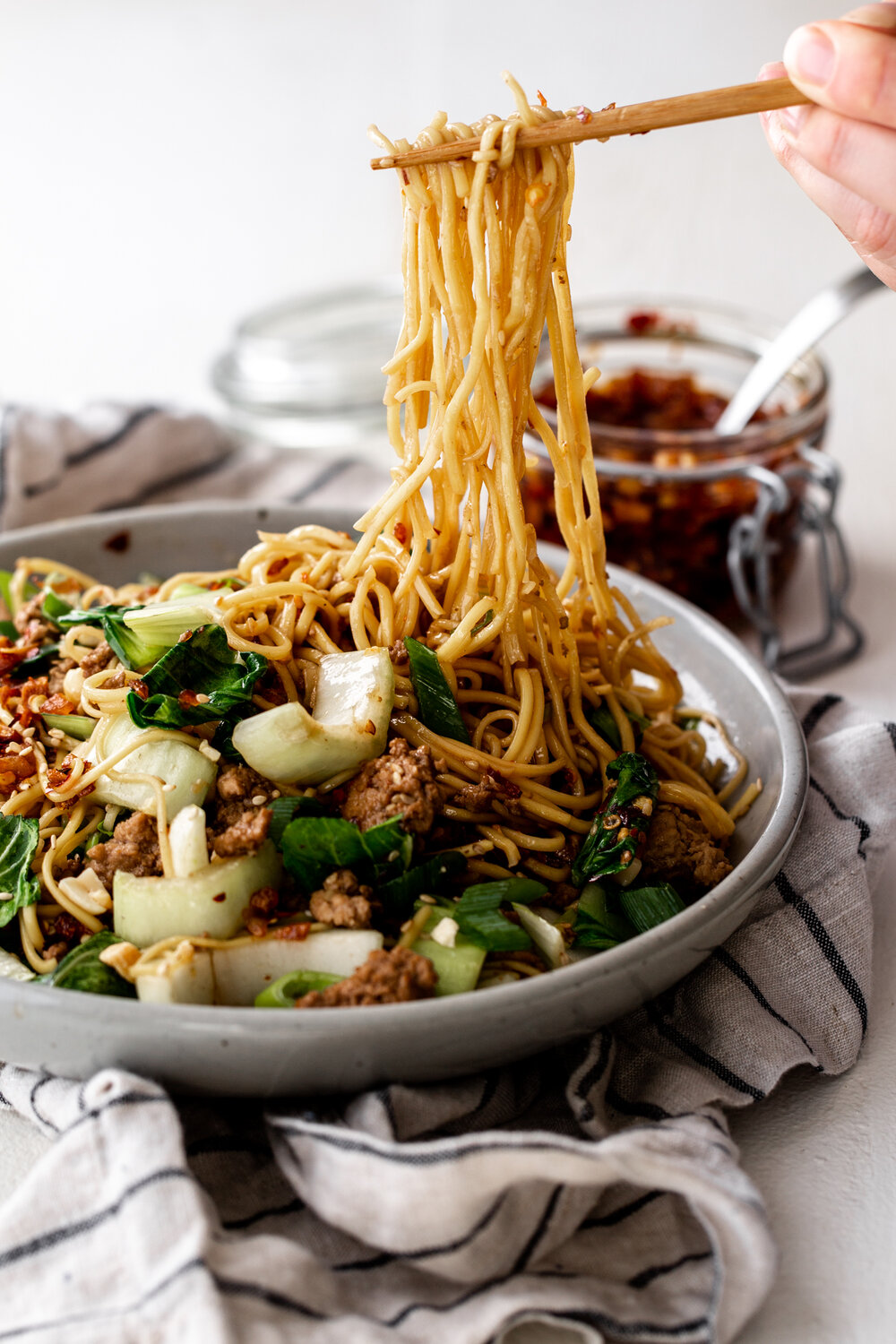 spicy dan dan noodles with bok choy and crunchy chili oil recipe from cooking with cocktail rings