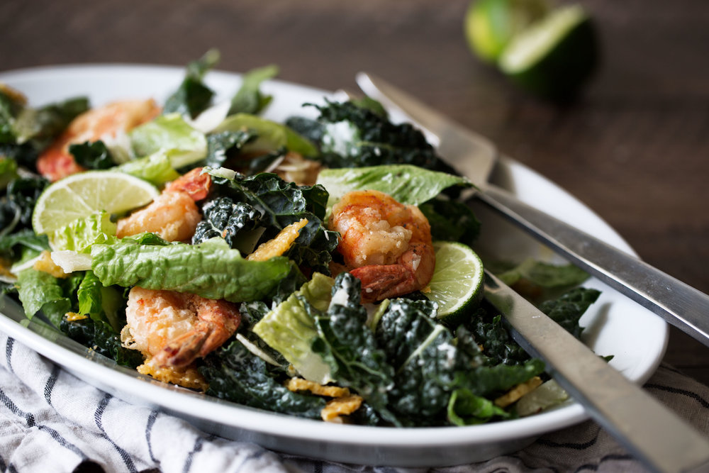 side view Kale Caesar Salad with Lime and Crispy Shrimp recipe from cooking with cocktail rings