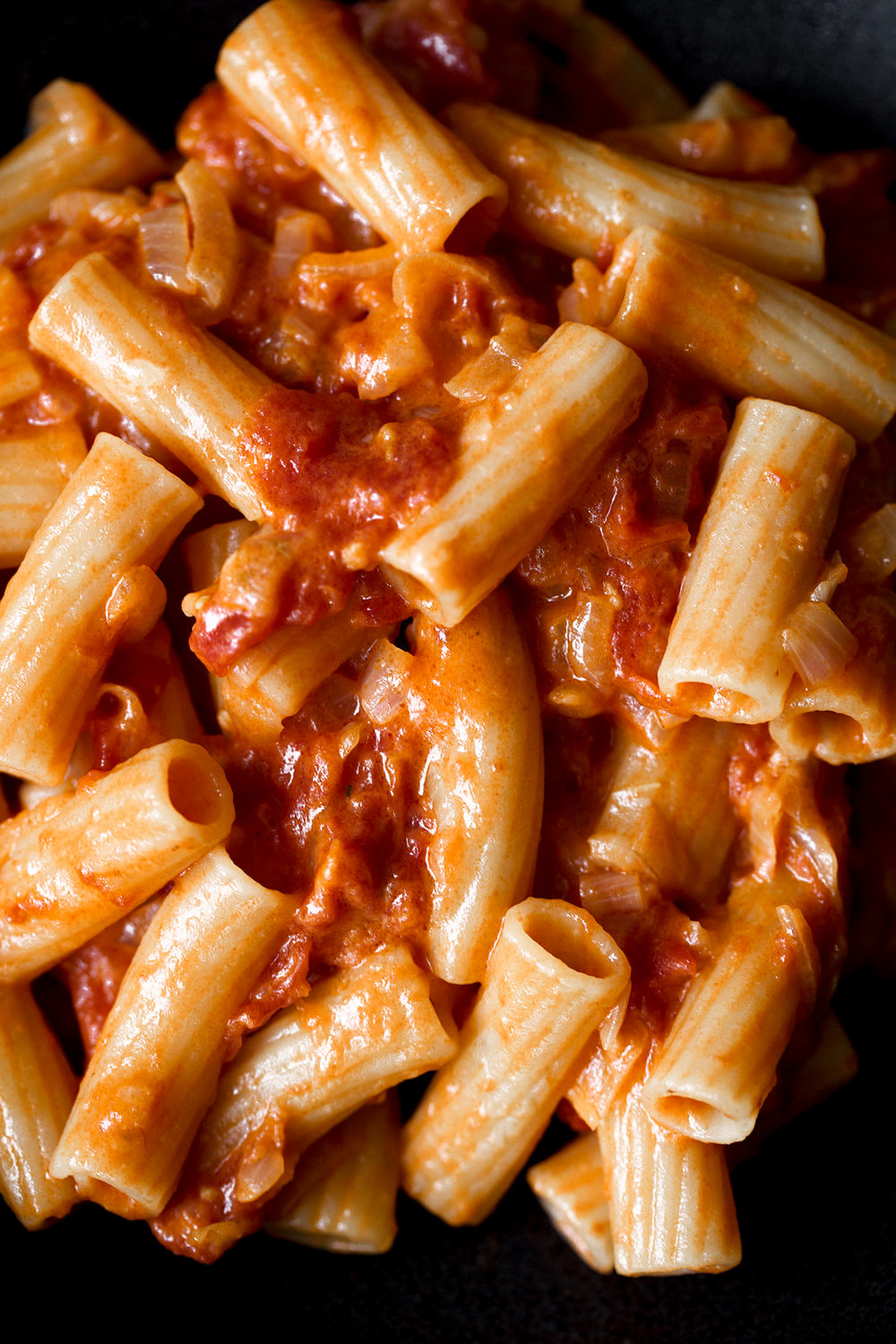 spicy rigatoni cooking with cocktail rings recipe closeup