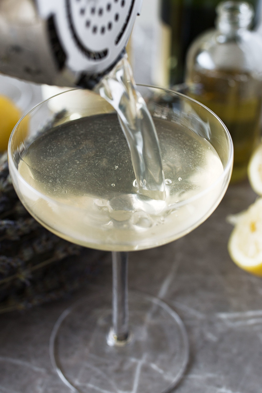 lavender lemon fizz pouring cocktail cooking with cocktail rings