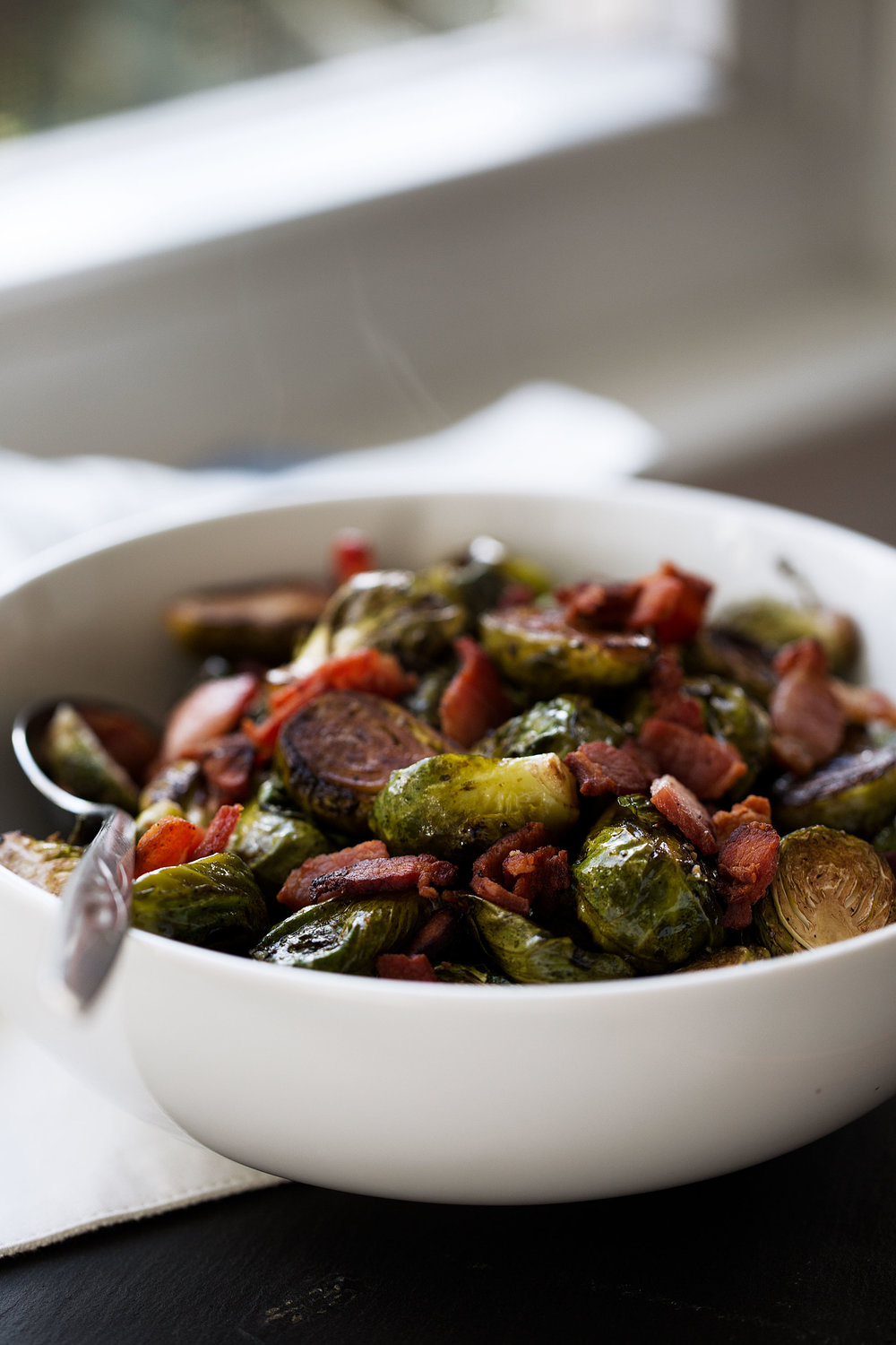 steaming balsamic brussels sprouts with bacon cooking with cocktail rings