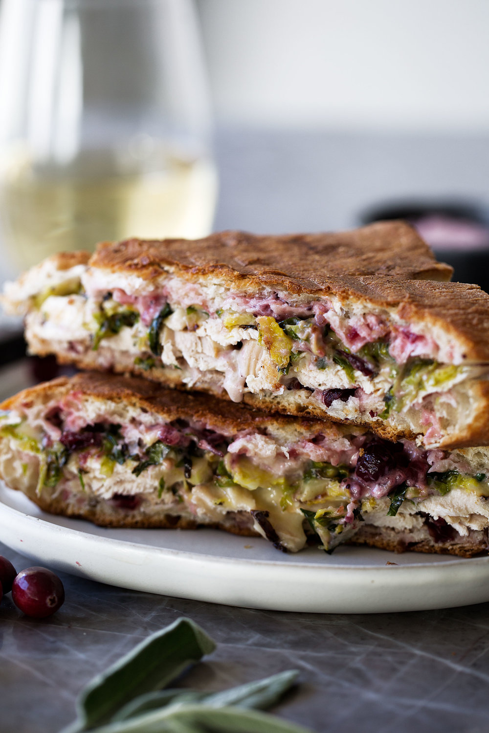 thanksgiving leftover panini with turkey, brie, shredded brussels sprouts and cranberry mayo recipe from cooking with cocktail rings