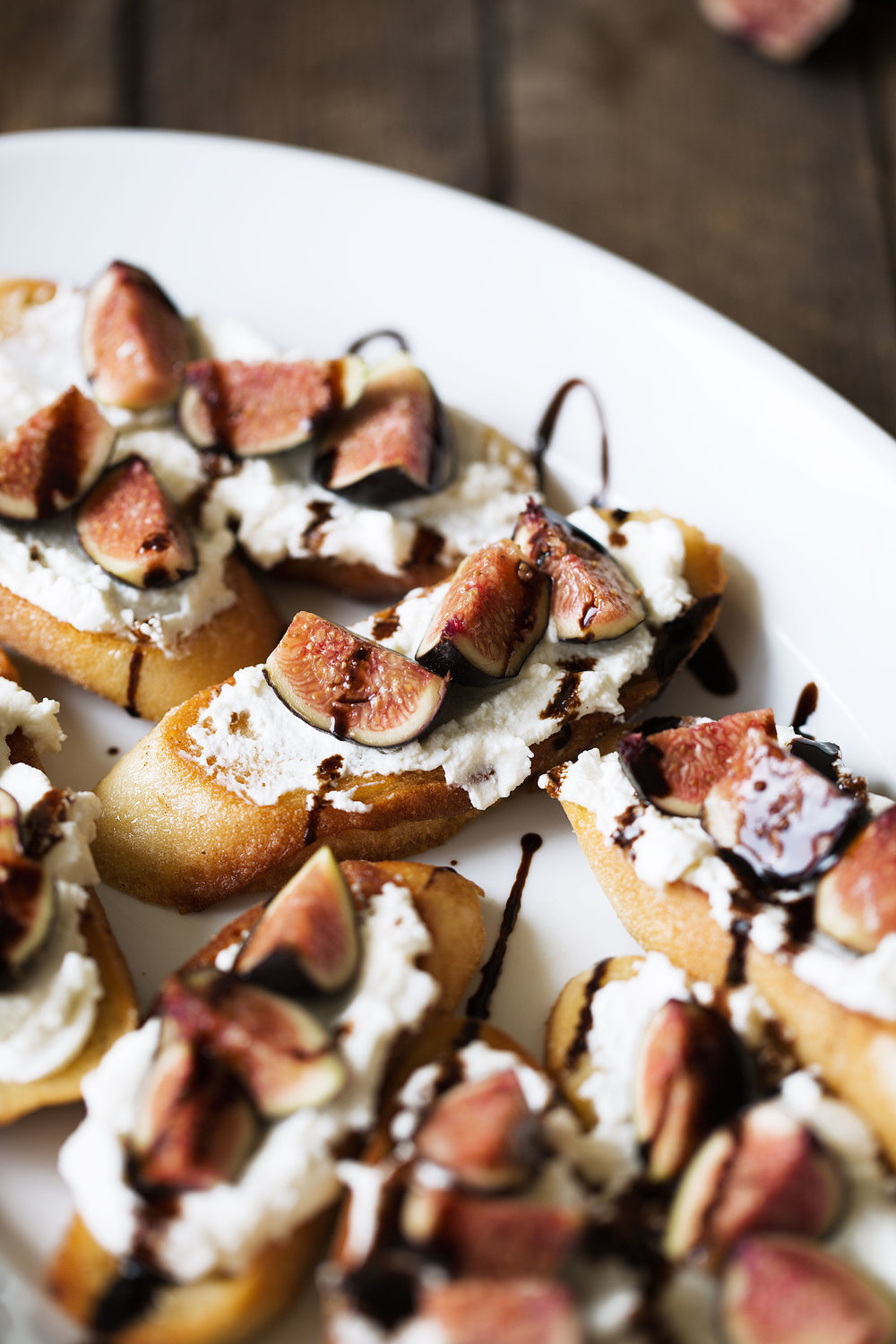 crostini with ricotta, figs and balsamic cooking with cocktail rings closeup side view