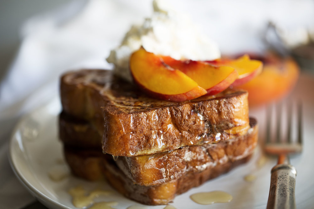 closeup grilled peaches and cream challah french toast cooking with cocktail rings