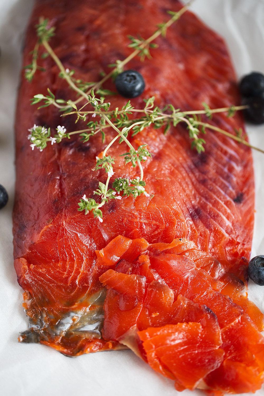 closeup blueberry-cured salmon gravlax