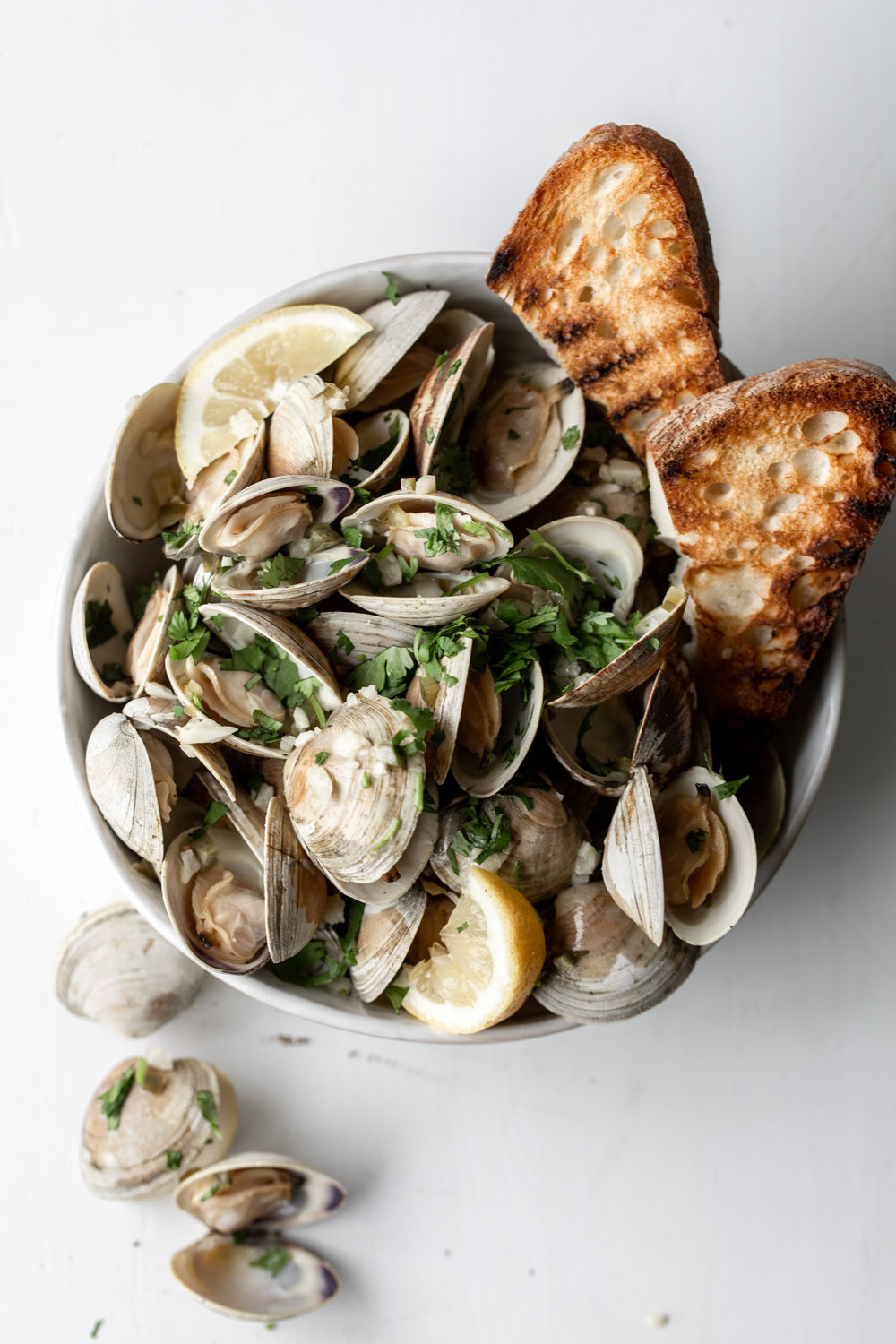 Clams in White Wine Sauce with Serrano Garlic Butter and Grilled Bread