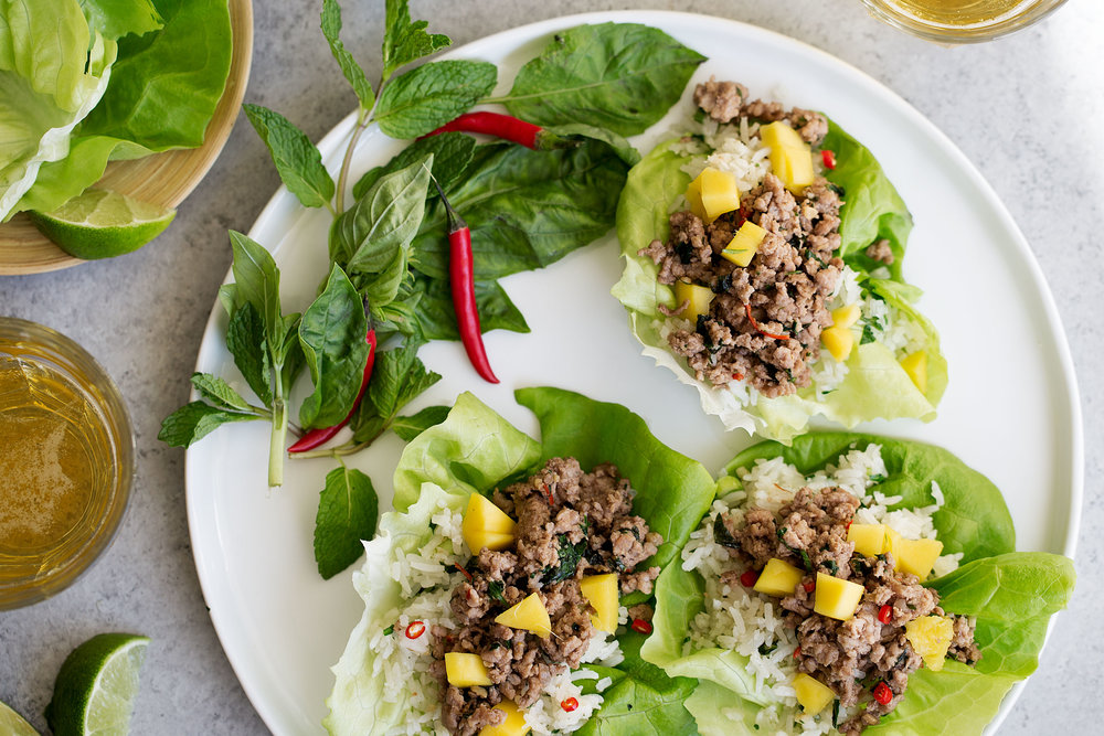 closeup asian pork lettuce wraps with coconut fried rice
