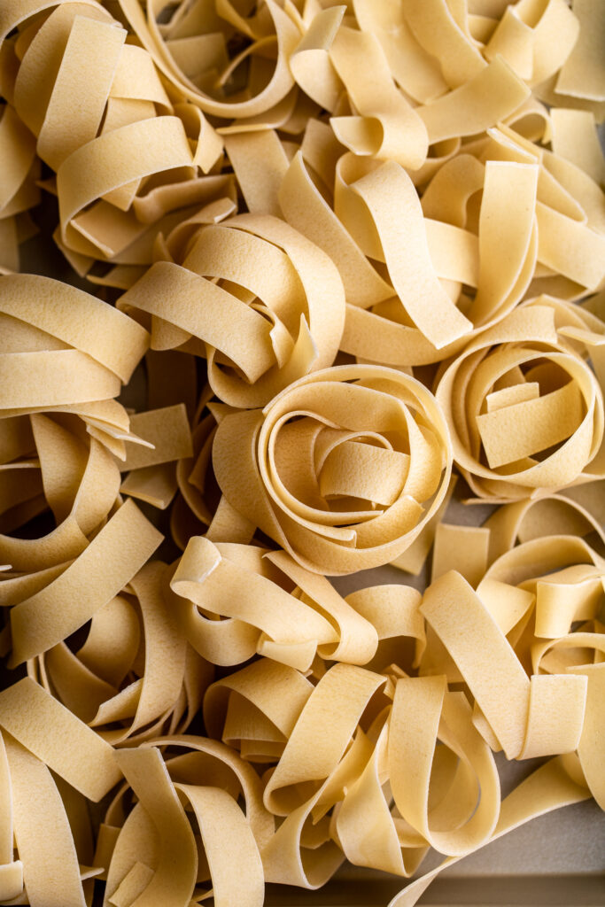 closeup dried pappardelle pasta nests
