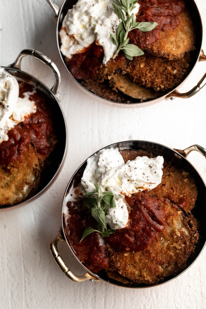 eggplant parmesan topped with burrata and marinara in small dishes
