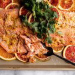 roasted salmon on a sheet pan with sliced oranges and blood oranges